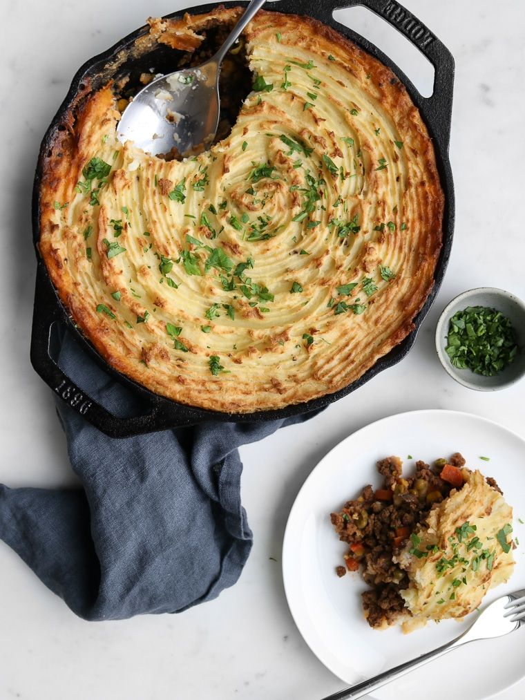Traditional Cottage Pie in a Cast Iron Skillet on a Napkin