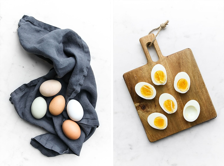 Left- Eggs on a blue napkin, Right - Boiled eggs cut in half on a cutting board