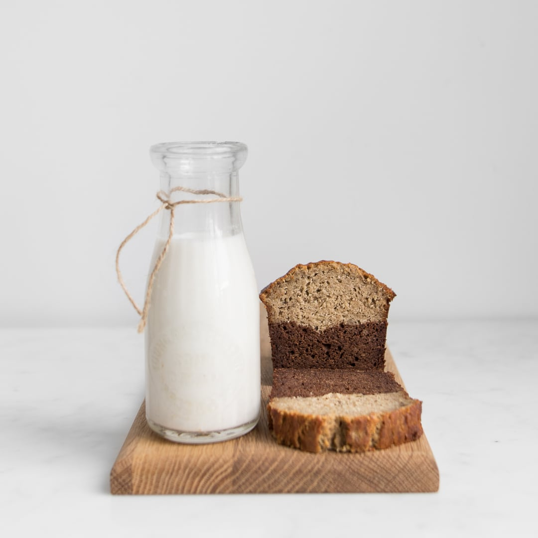 Half chocolate, half banana bread next to bottle of milk