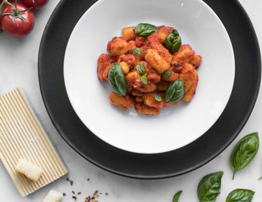 Close up of Whole30 Gnocchi in a white bowl with black charger
