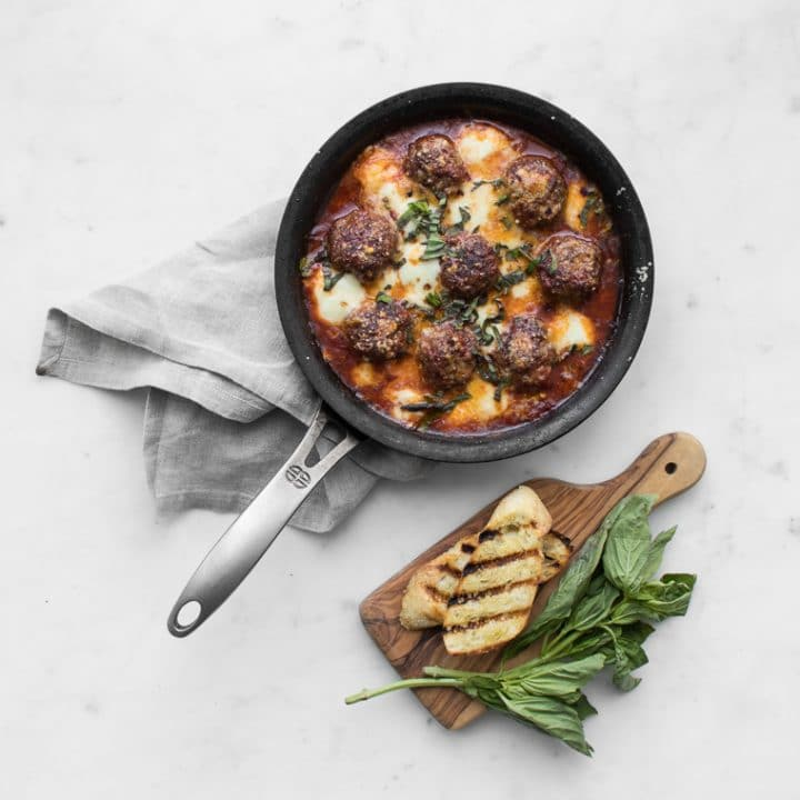 Spicy meatballs with golden baked mozzarella and parmesan cheese