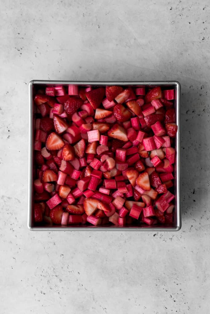 Baking dish with chopped strawberries and rhubarb