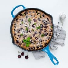 Cherry Clafoutis in a blue skillet