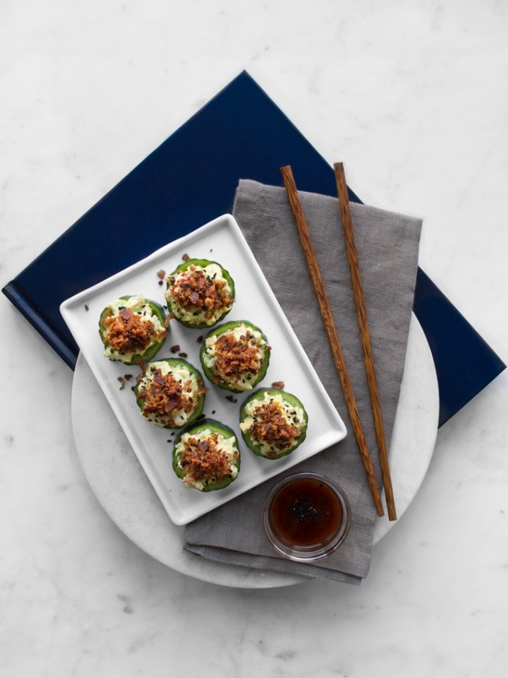 Crab Cucumber Cups with Bacon Plated on a Napkin with Chop Sticks