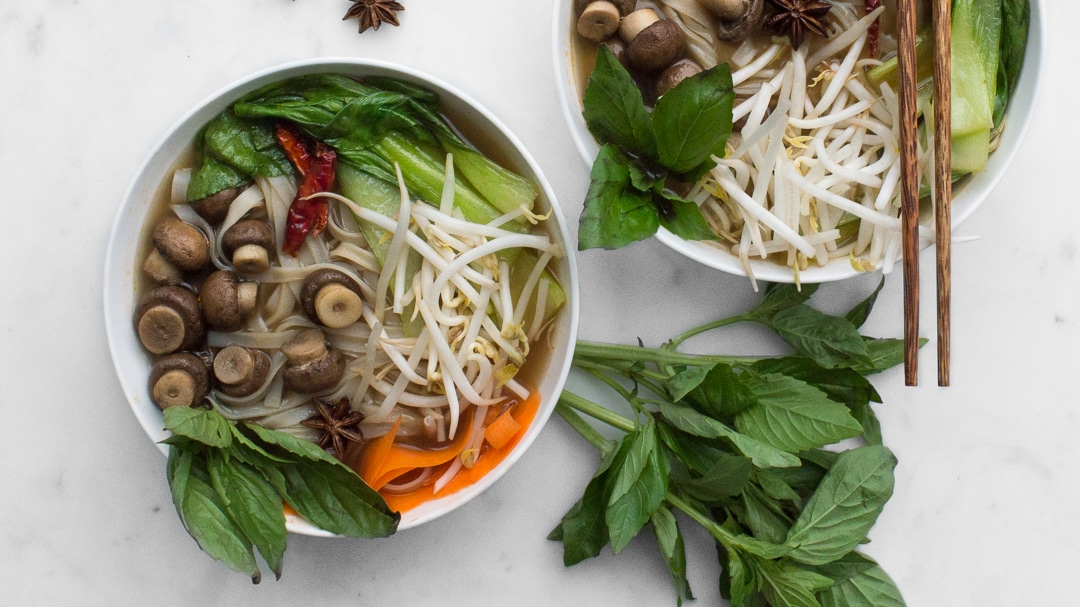 Two bowls for Vegetarian Pho with basil