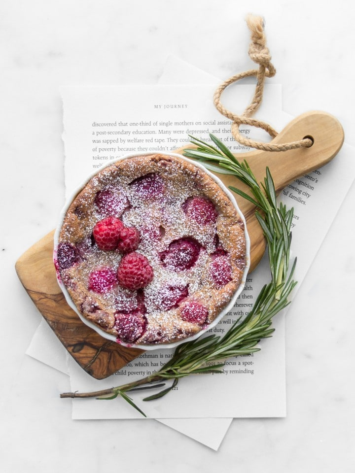 Small raspberry clafoutis on a small wooden board
