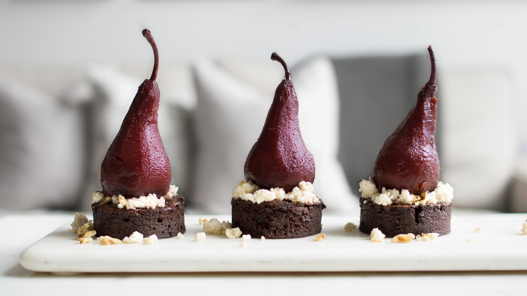 Three Port Poached Pears on Chocolate Cake