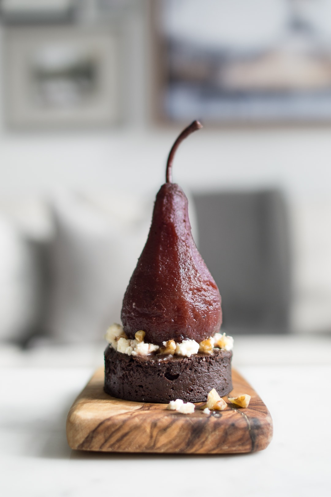 Side view of Poached Pear on Chocolate Cake with Blue Cheese