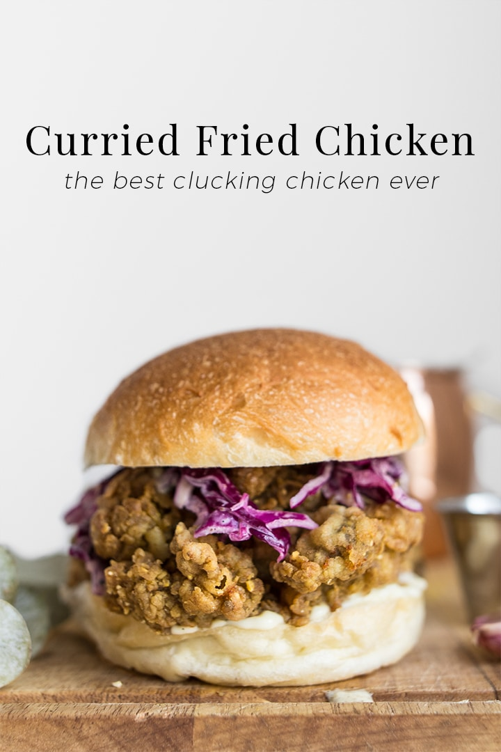 Curry Fried Chicken Sandwich Recipe - Inspired by Donna Hay's Katsu Curry Fried Chicken Burger, we put an Island twist on her version by marinating the chicken in West Indian curry, scotch bonnets, and sweet mango. This paste collects all the flour and makes for the crispiest, most flavourful chicken sandwich you'll ever have.   chefsouschef.com #realfood #comfortfood #chicken #sandwich #foodphotography #chefsouschef