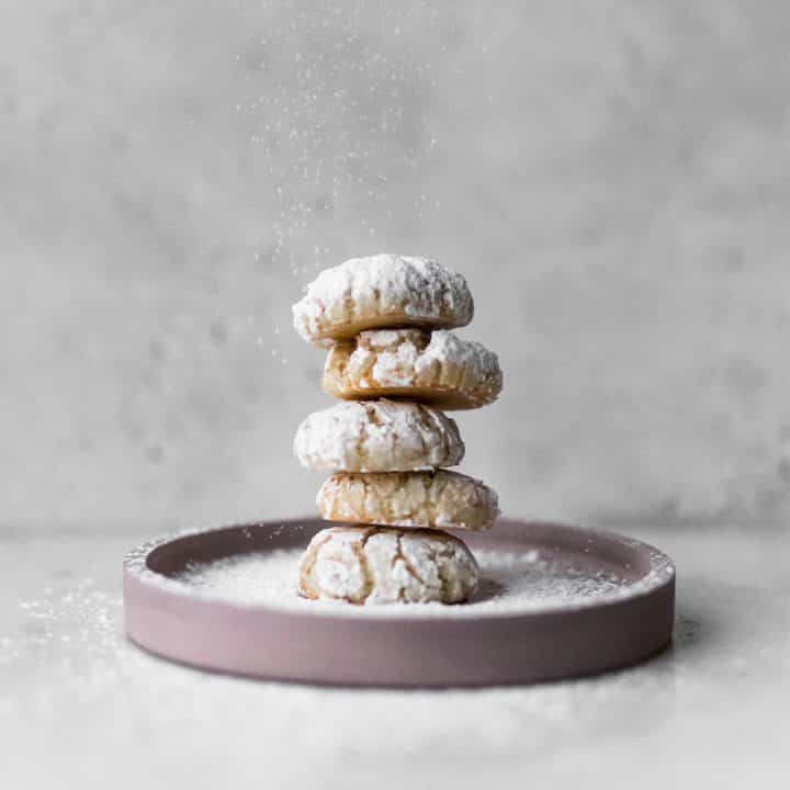 Pink plate with five amaretti cookies on it