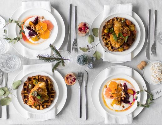 Flat lay of chicken and waffles, and beet and orange salad