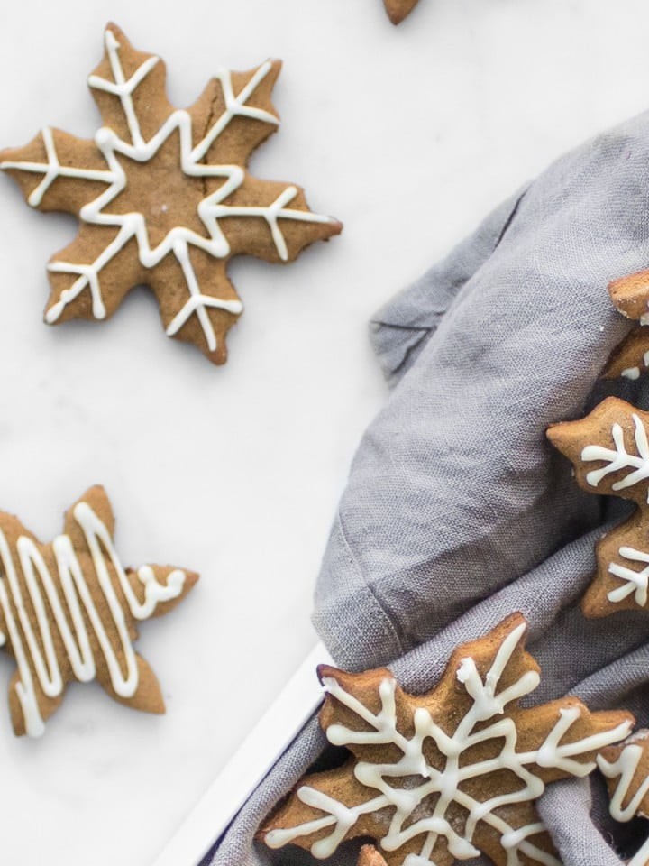 Close up of snowflake gingerbread cookies decorated with icing