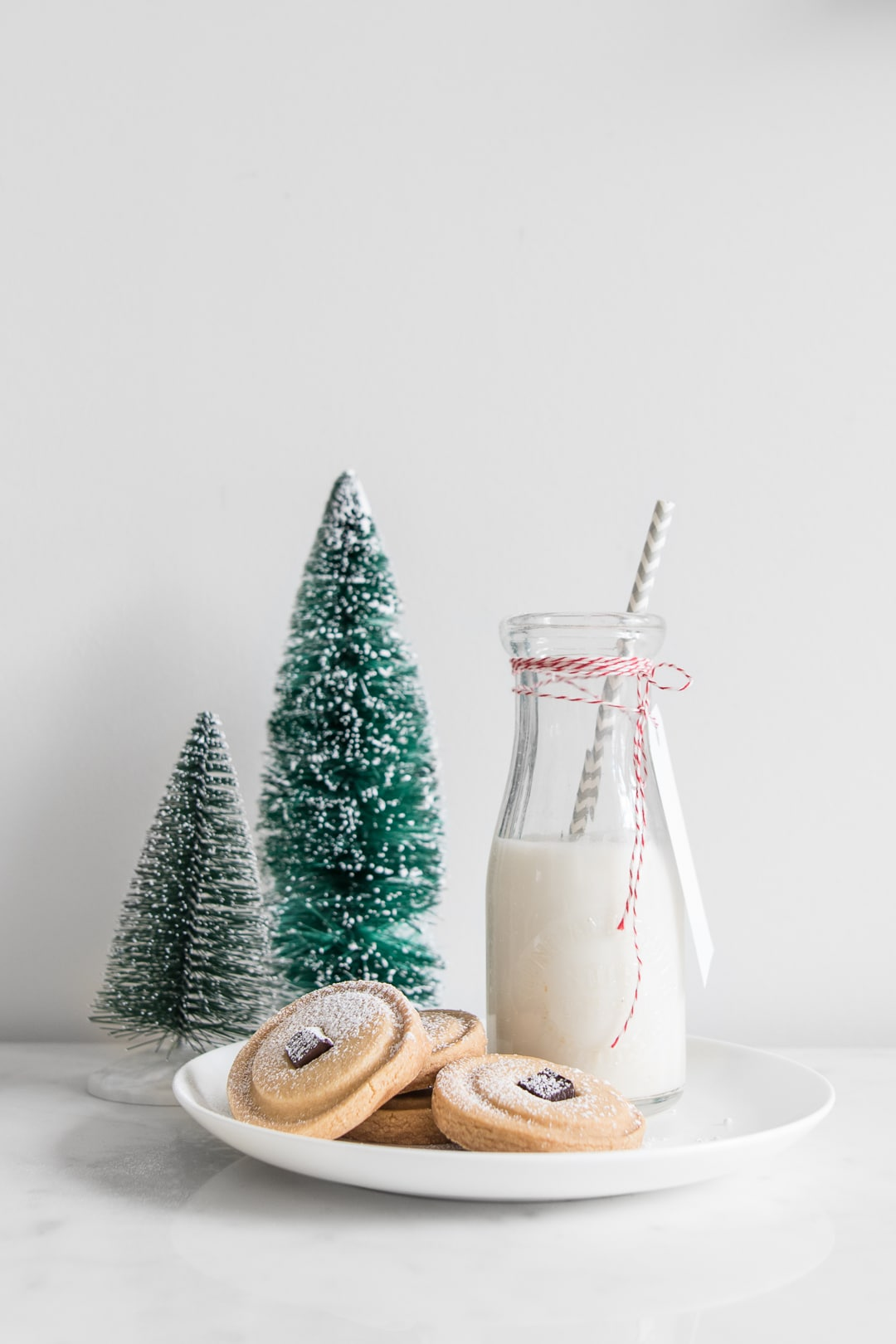Holiday Cookie Recipes Mary MacLeod's Shortbread with glass bottle of milk and mini Christmas trees