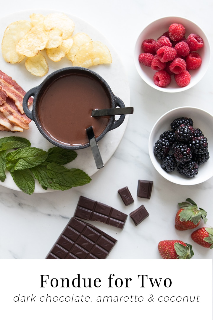 Dark Chocolate Fondue for Two - Using rich dark chocolate, creamy coconut milk and a splash of almond liqueur, our Chocolate Fondue for Two recipe is silky, decadent, and perfect for dipping fun and fresh ingredients while igniting all the senses. #chocolate #fondue #dessert #Valentines #chefsouschef