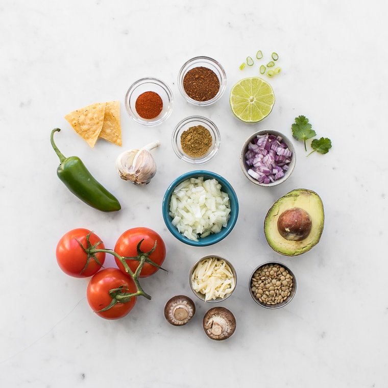 Ingredients for Lentil Nachos laid out on a marble table