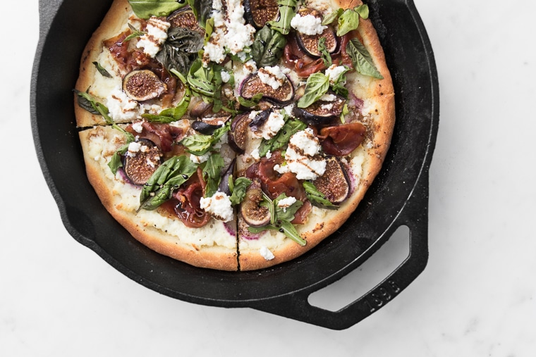Cooked Fig and Prosciutto Pizza in a cast iron pan fresh out of the oven