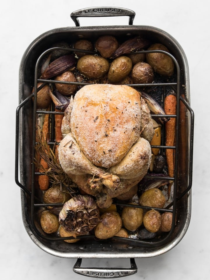 Roast chicken in a roasting pan with vegetables
