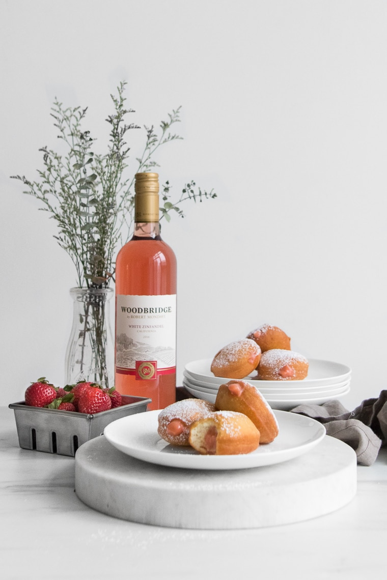 2 Plates of Jelly Filled Donuts with Rose Wine and Strawberries