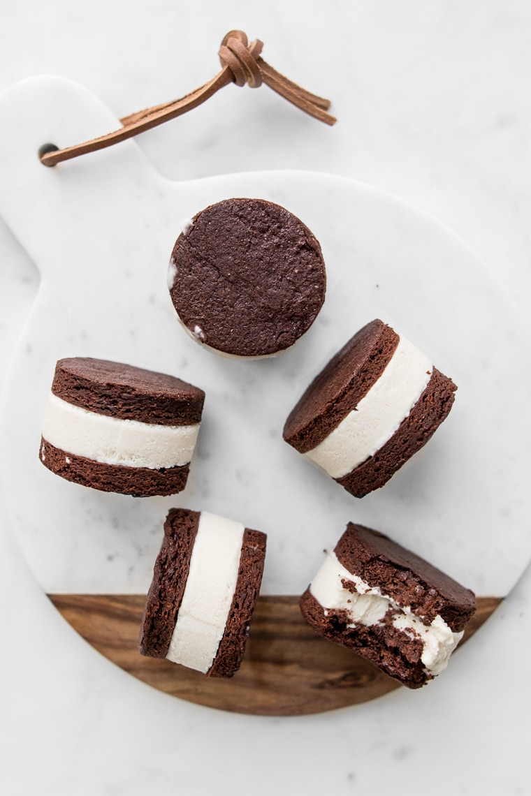 Coconut Ice Cream Sandwiches on a marble and wooden board
