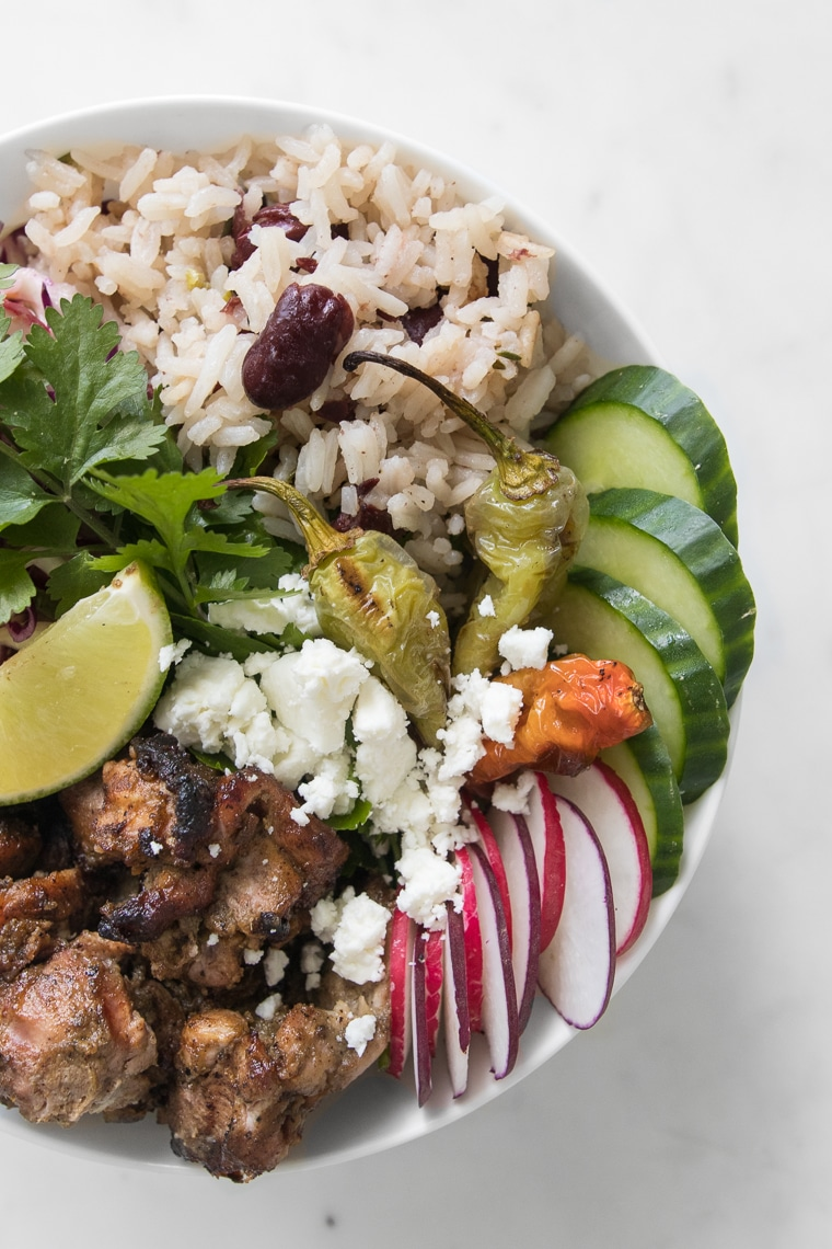 Close up of BBQ Jerk Chicken Bowl with Rice and Peas + Pineapple Coleslaw