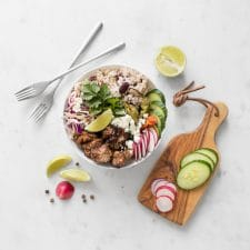 Flat lay of BBQ Jerk Chicken Bowl with Rice and Peas