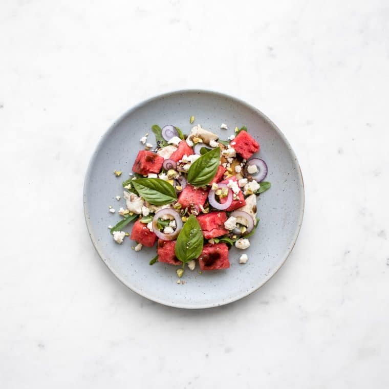 Chicken, Watermelon and Feta Salad on a blue plate