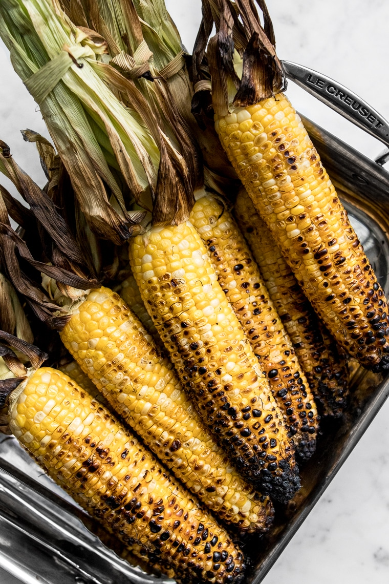 Grilled corn with husks peeled back