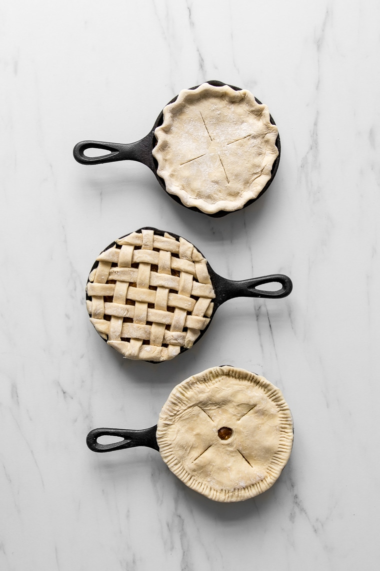 Three beef pot pies with different crust styles before baking