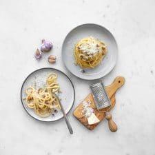 Two plates of spaghetti carbonara