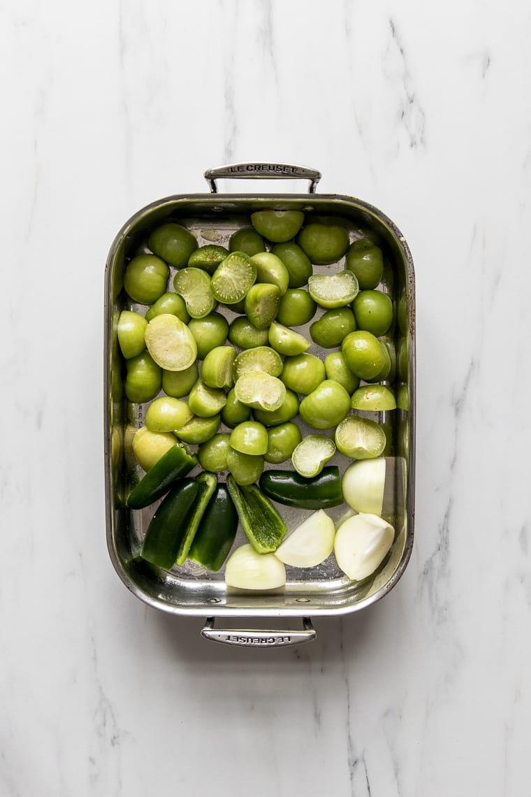 Roasting pan with tomatillos, onions and jalapenos