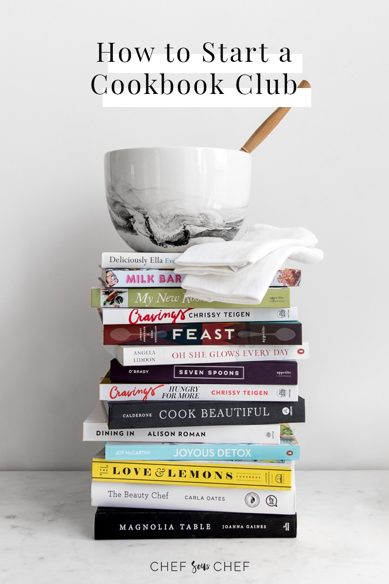 A stack of cookbooks with a bowl on top