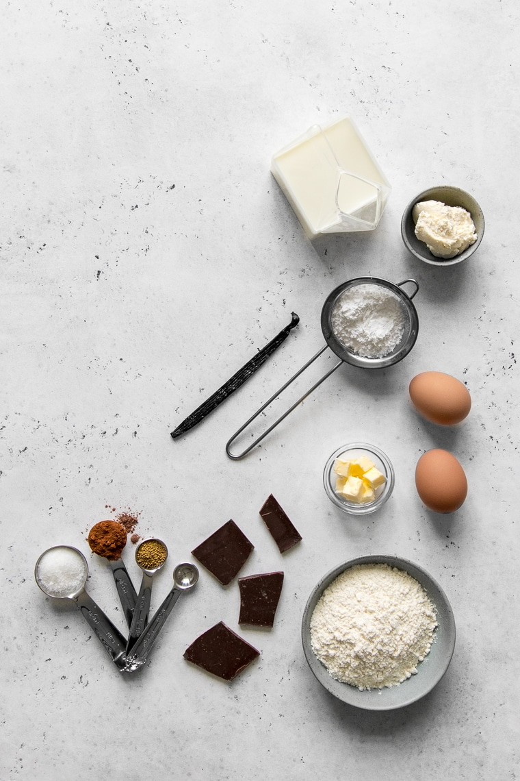 Ingredients for chocolate rolls with cream cheese frosting laid out on a table