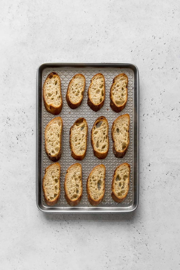 Baguette toasts on a baking sheet