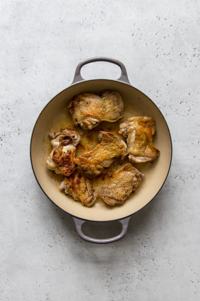 Chicken with crispy skin in a le creuset braiser