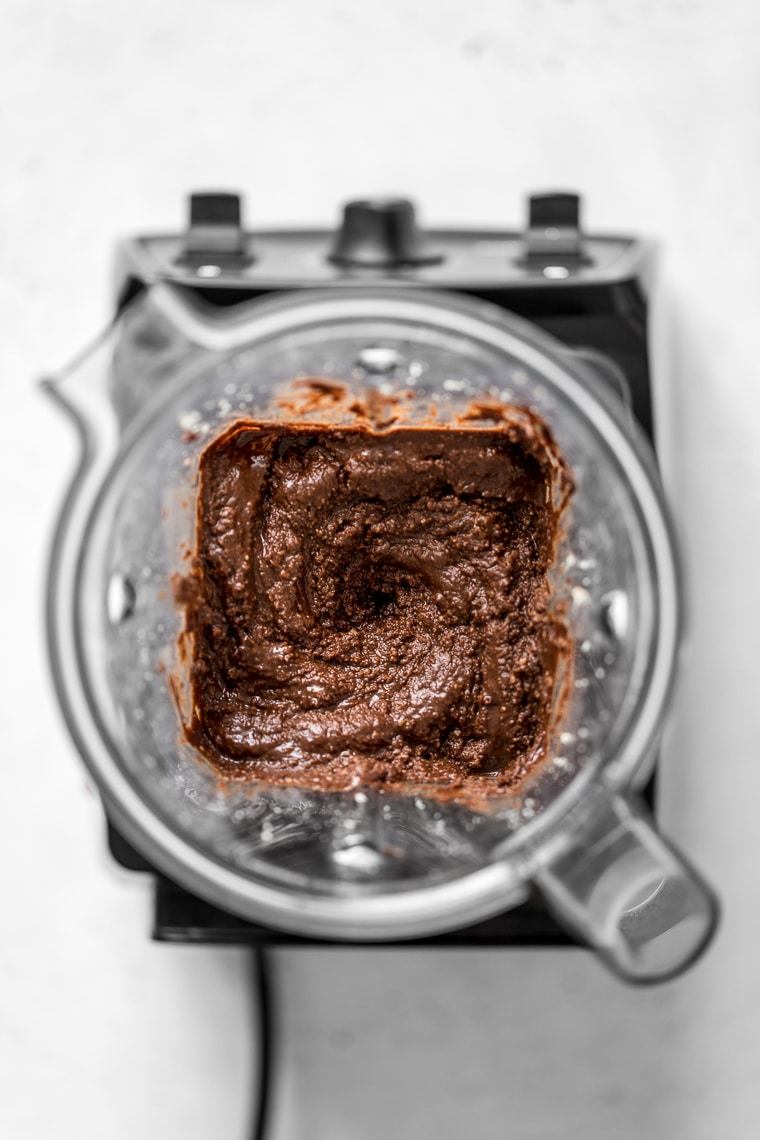 Homemade Chocolate Hazelnut Nut Spread in a blender container - Image from overhead