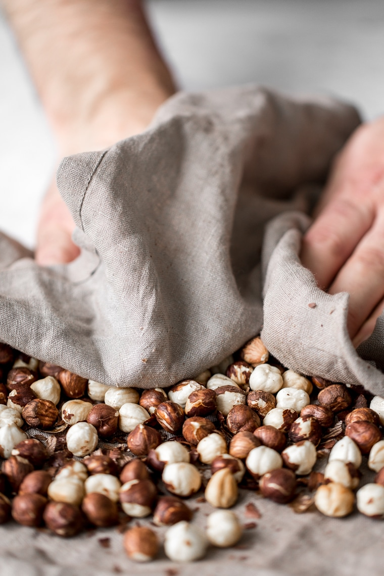 Rubbing the skins off the hazelnuts using a towel