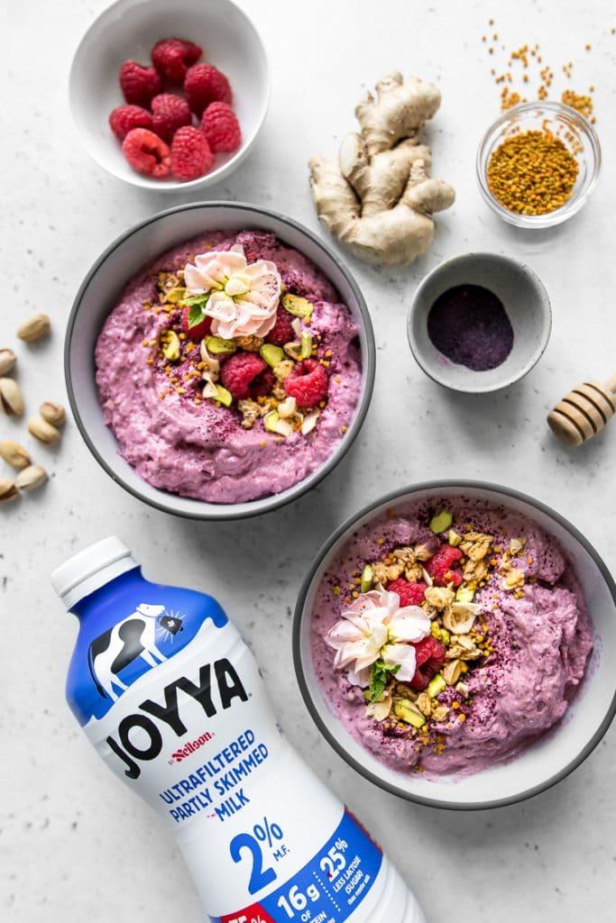 Two smoothie bowls with Joyya Milk Bottle