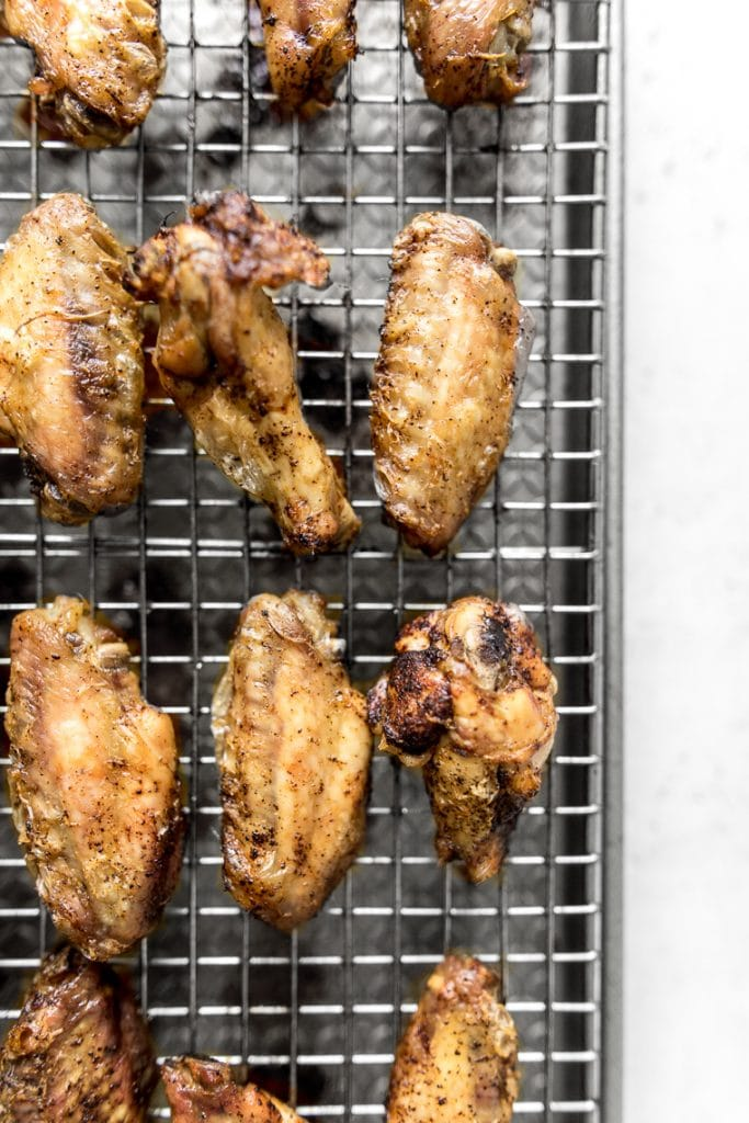 Baked chicken wings on a wire cooling rack