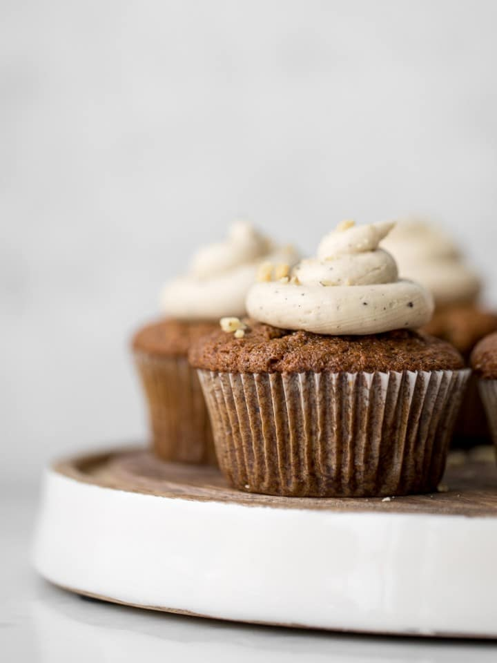 Close up of carrot cake muffin with brown butter frosting