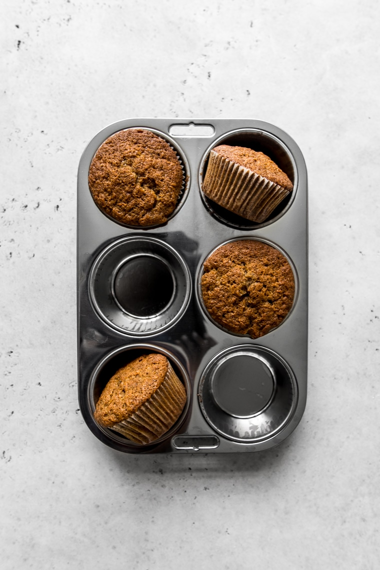 Four muffins in a muffin pan