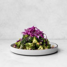 Plate of broccoli salad with red cabbage and peanu