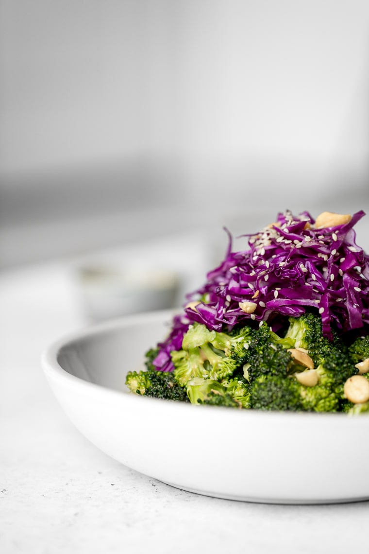 Close up of Raw Broccoli Salad wth Red Cabbage on Top