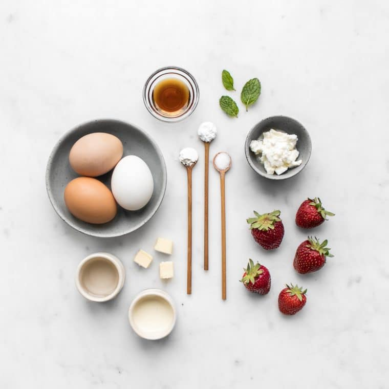 Ingredients for Strawberry Shortcake Laid Out on Marble Table