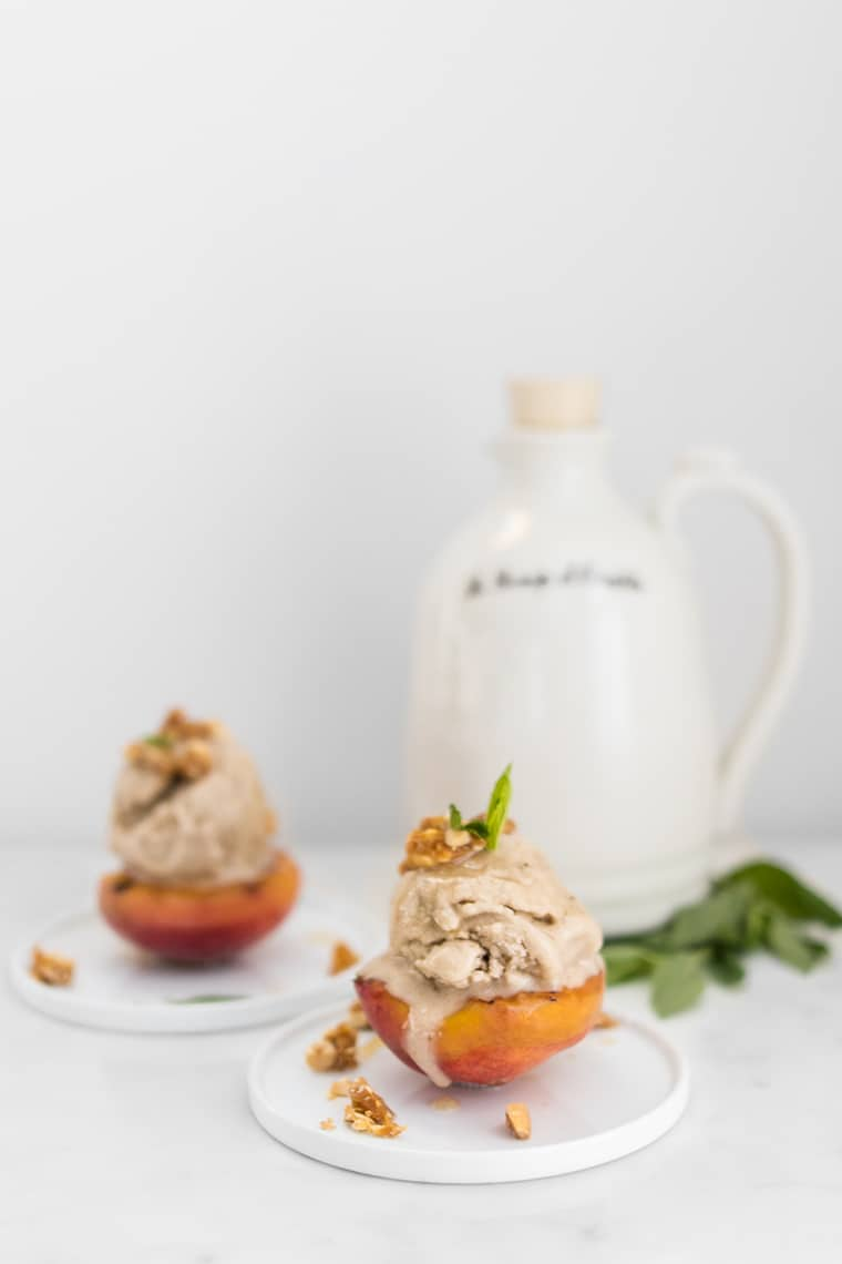 Peaches with Banana Ice Cream and Nuts with Maple Syrup container in the background