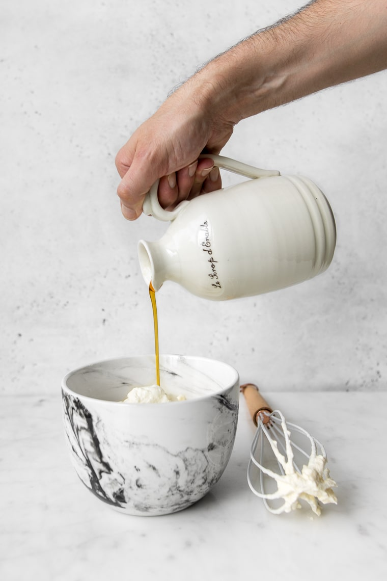 Pouring maple syrup into whipped cream