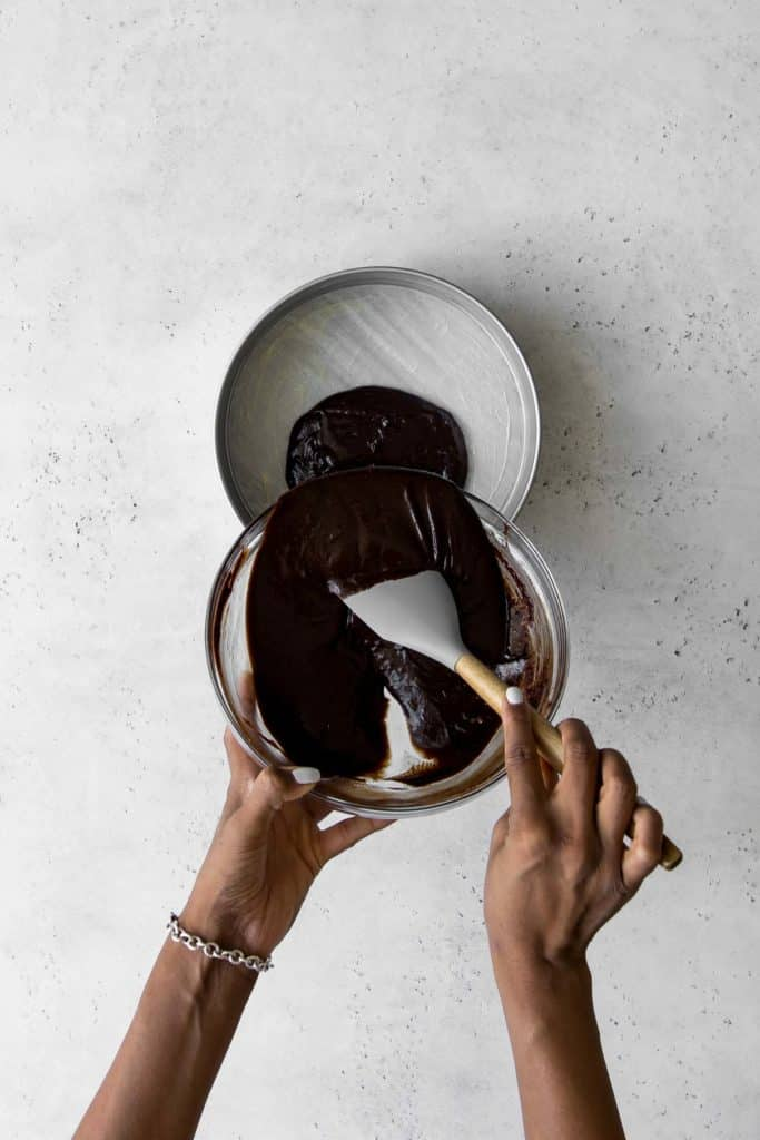 Pouring chocolate batter into a springform pan