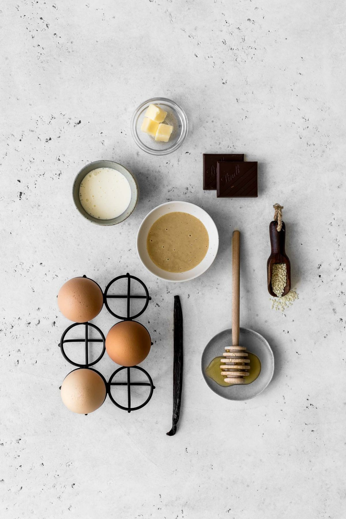 Ingredients to make tahini and chocolate flourless cake