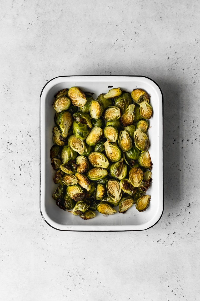 Roasted brussels sprouts in a baking pan