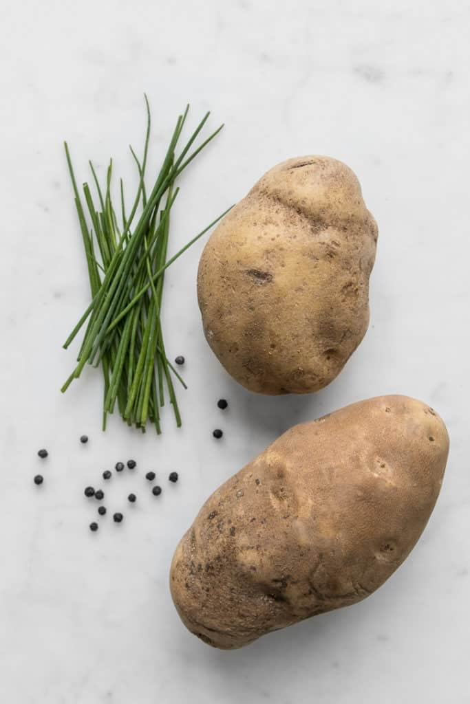 two russet potatoes, chives, and black peppercorns