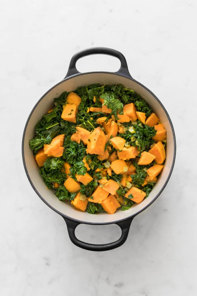 Round french oven with braised kale and sweet potatoes